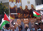 Palestinian children attend a demonstration calling for the release of prisoners held in Israeli jails and in support of inmates in hunger strike, on Oct, 06, 2011 in the West Bank city of Ramallah. Thousands of Palestinian inmates in Israeli jails launched a hunger strike in protest against the policy of solitary confinement. Photo by Issam Rimawi