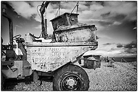 Tractor and fishermen on the beach at Dungeness, Kent