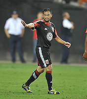 Carlos Ruiz (20) of D.C. United salutes the fans after scoring in the 73th minute of the game. C.D.Guadalajara tied D.C. United 1-1 during and international friendly, at RFK Stadium, Friday July 12, 2013.