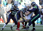 Seattle Seahawks linebacker K.J. Wright (50), defensive tackle Ahtyba Rubin (77) tackles San Francisco 49ers  tight end Garrett Celek (88) as Seahawks cornerback  Cary Williams (26) moves in to help at CenturyLink Field in Seattle, Washington on November 22, 2015.  The Seahawks beat the 49ers 29-13.   ©2015. Jim Bryant Photo. All RIghts Reserved.