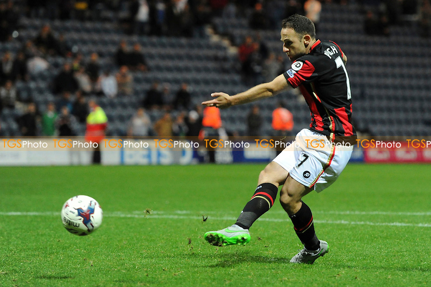 Marc Pugh of Bournemouth scores his penalty in the shootout during Preston North End vs AFC Bournemouth at Deepdale