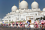 The peloton pass the sights during Stage 2, The Capital Stage, of the 2015 Abu Dhabi Tour running 129 km from Yas Marina Circuit to Yas Mall, Abu Dhabi. 9th October 2015.<br /> Picture: ANSA/Claudio Peri | Newsfile
