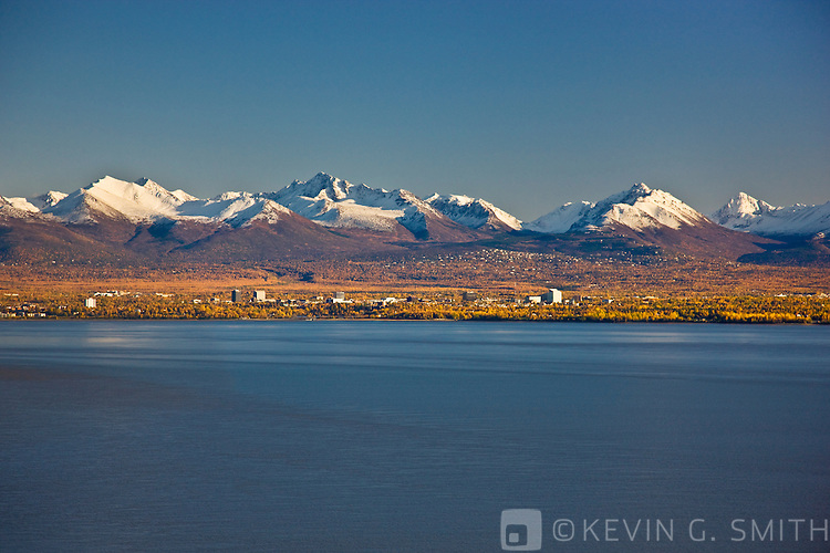 Aerial photo of the Anchorage Skyline, looking southeast over Knik Arm with the Chugach Mountains in the background, Fall, Anchorage, Southcentral Alaska, USA.