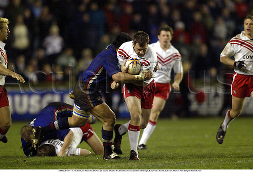 DARREN BRITT is tackled, ST HELEN'S SAINTS 39 v Sale Sharks 41, BetHiLo Cross Code Challenge, Knowsley Road, 030127. Photo: Neil Tingle/Action Plus...2003.Rugby league.tackle tackles tackling..