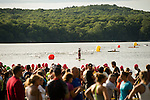MIDLEBURY, CT-8 July 2015-070815EC05-  Spectators mill around moments after the start of the swim portion of the 28th Annual Pat Griskus Sprint Triathlon Wednesday night in Middlebury. Erin Covey Republican-American