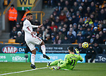 Rui Patricio of Wolverhampton Wanderers saves at the feet of Lys Mousset of Sheffield Utd during the Premier League match at Molineux, Wolverhampton. Picture date: 1st December 2019. Picture credit should read: Simon Bellis/Sportimage