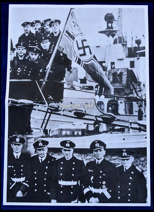 BNPS.co.uk (01202 558833)<br /> Pic: SAS/BNPS<br /> <br /> Crew pose with the stern flag from the Grille.<br /> <br /> Adolf Hitler's personal standard that was flown on his luxurious yacht until it was seized by a souvenier-hunting Royal Navy seaman has emerged for sale.<br /> <br /> Signalman Jack Lee removed the highly sought-after Nazi swastika flag after the vessel, called the Grille, was taken over by the navy at the end of the Second World War.<br /> <br /> SM Lee found the 39ins by 67ins red and black flag that had been hidden on board by the German crew.<br /> <br /> Accompanying the flag is a remarkable letter from his describing the luxurious surroundings if thee 443ft long yacht.