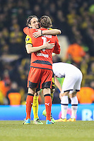 Roman Weidenfeller of Borussia Dortmund (right) and Neven Subotic of Borussia Dortmund (left) celebrate victory against Tottenham Hotspur after the UEFA Europa League match between Tottenham Hotspur and Borussia Dortmund at White Hart Lane, London, England on 17 March 2016. Photo by David Horn / PRiME Media Images