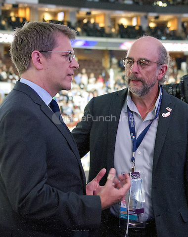 Former White House Press Secretary Jay Carney and actor Richard Schiff have a conversation over the podium at the 2016 Democratic National Convention held at the Wells Fargo Center in Philadelphia, Pennsylvania on Tuesday, July 26, 2016.<br /> Credit: Ron Sachs / CNP/MediaPunch<br /> (RESTRICTION: NO New York or New Jersey Newspapers or newspapers within a 75 mile radius of New York City)