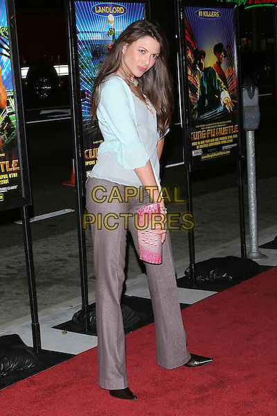 "KARI WUHRER.""Kung Fu Hustle"" Los Angeles Premiere held at the ArcLight Cineramadome, Hollywood, California..Photo Credit: Jacqui Wong/AdMedia.March 29th, 2005.full length blue top grey gray trousers pink clutch purse.www.capitalpictures.com.sales@capitalpictures.com.© Capital Pictures."