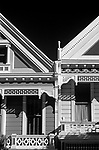 Victorian style homes close up of ornate exterior along Steiner street at Alamo Square, San Francisco, California USA