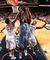 North Carolina forward Kennedy Meeks (3) reaches for the rebound with Virginia forward Anthony Gill (13) and Virginia guard Malcolm Brogdon (15) during an NCAA basketball game against Virginia Monday Jan. 20, 2014 in Charlottesville, VA. Virginia defeated North Carolina 76-61.