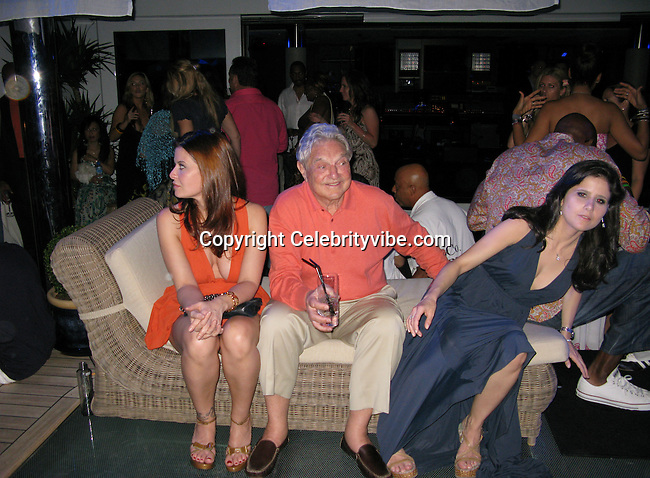 **EXCLUSIVE**.George Soros and Adriana Ferreyr..Paul Allen Party..Octopus Yacht..St. Barth, Caribbean..Tuesday, December 30, 2008..Photo By Celebrityvibe.com.To license this image please call (323) 325-4035; or .Email: celebrityvibe@gmail.com ;.website: www.celebrityvibe.com