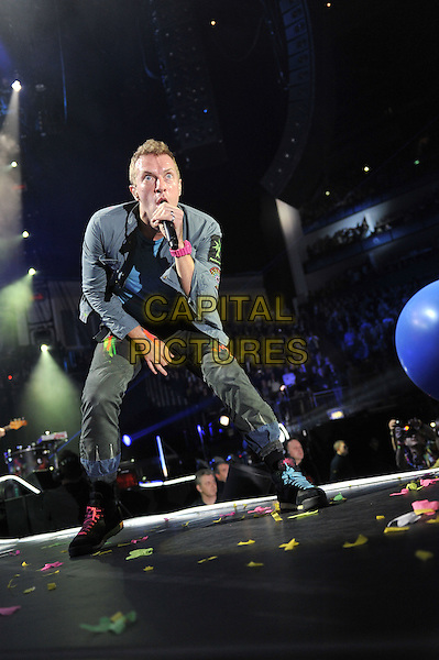 Chris Martin.Coldplay performing live in concert, O2 Arena, Greenwich, London, England. .9th December 2011.stage gig performance music full length blue jacket  black singing bending leaning .CAP/MAR.© Martin Harris/Capital Pictures.