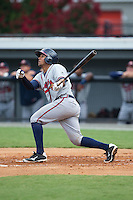 Carlos Martinez (8) of the Danville Braves follows through on his swing against the Burlington Royals at Burlington Athletic Park on July 12, 2015 in Burlington, North Carolina.  The Royals defeated the Braves 9-3. (Brian Westerholt/Four Seam Images)