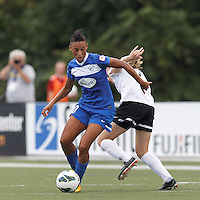 Boston Breakers forward Lianne Sanderson (10) collects a pass and starts to elude Portland Thorns FC defender Nikki Marshall (7). In a National Women's Soccer League (NWSL) match, Portland Thorns FC (white/black) defeated Boston Breakers (blue), 2-1, at Dilboy Stadium on July 21, 2013.