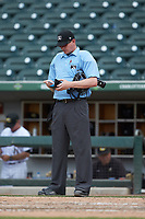 Home plate umpire Ryan Wills checks his lineup card during the International League game between the Indianapolis Indians and the Charlotte Knights at BB&T BallPark on August 22, 2018 in Charlotte, North Carolina.  The Indians defeated the Knights 6-4 in 11 innings.  (Brian Westerholt/Four Seam Images)