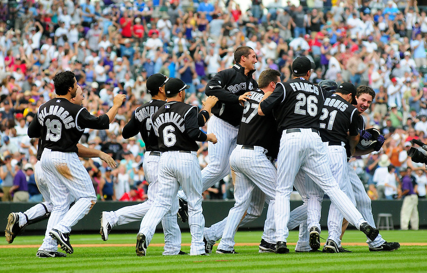 July 12, 2009: Rockies all star outfielder Brad Hawpe, far right, is bombarded by teamates after hitting a walk-off RBI double in the 9th inning during a regular season game between the Atlanta Braves and the Colorado Rockies at Coors Field in Denver, Colorado. Pictured are Rockies players Ryan Spilborghs, Carlos Gonzalez, Omar Quintanilla, Huston Street, Garrett Atkins,  Jeff Francis, Randy Flores, and Jason Marquis.The Rockies beat the Braves 8-7.