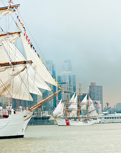 The Eagle and Cisne Branco crossing in front of the Manhattan skyline during the Parade of Sail for OpSail New York, 2012