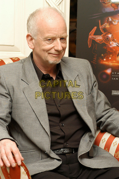 "IAN McDIARMID.Photocall for ""Star Wars Episode III: Revenge of the Sith"".Rome, Italy, May 19th 2005..half length sitting.Ref: CAV.www.capitalpictures.com.sales@capitalpictures.com.©Luca Cavallari/Capital Pictures."