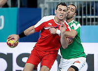 Algeria's Omar Benali (r) and Egypt's Omar Elsweidy during 23rd Men's Handball World Championship preliminary round match.January 15,2013. (ALTERPHOTOS/Acero) /NortePhoto