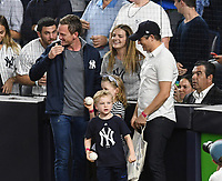 NEW YORK, NY - October 8 : Neil Patrick Harris, David Burtka and kids on field at Yankee Stadium during game 3 of the ALDS on October 8,2017 Bronx New York . @John Palmer / Media Punch