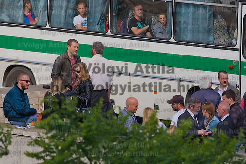 US actor Bruce Willis (bottom C) and costars Jai Courtney (3nd L) of  Australia and Sebastian Koch (4th L are seen talking during a shooting of the fifth piece in the Die Hard series titled Good Day to Die Hard during a shooting day in Budapest, Hungary on May 19, 2012. ATTILA VOLGYI
