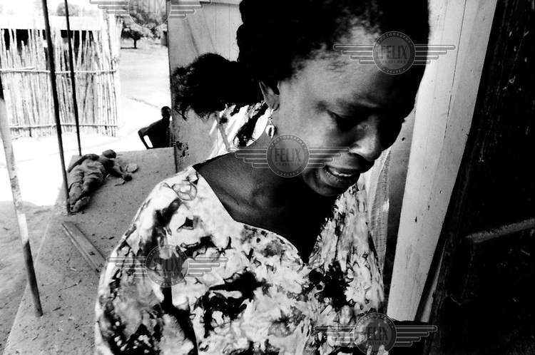 A jet from the West African peacekeeping force ECOMOG has bombed Makeni, which was at that time a stronghold of the military AFRC and RUF rebel junta, a coalition of army officers and rebels. A woman cries when she finds the body of a relative killed in the ECOMOG attack.