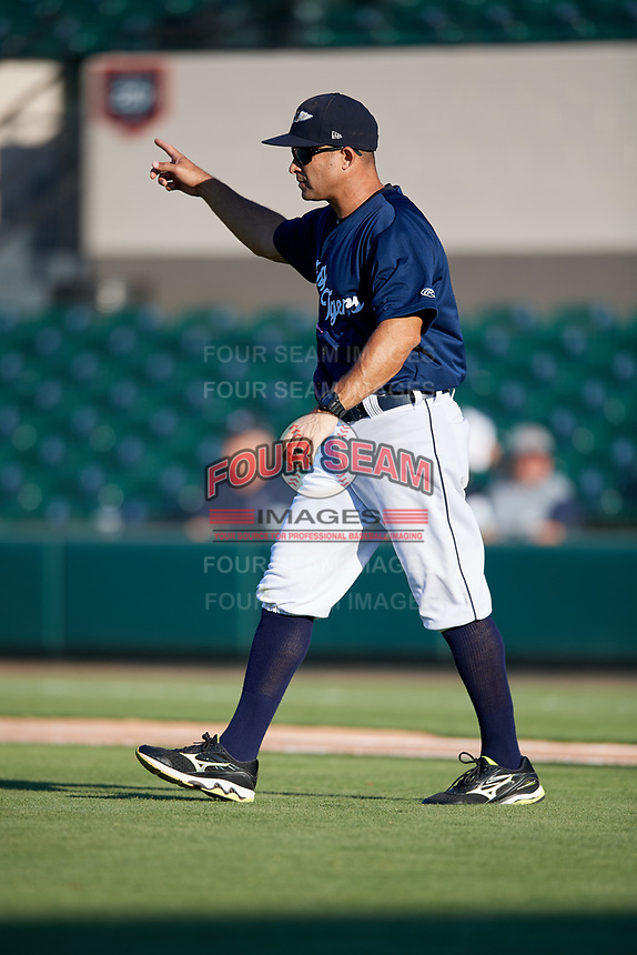 Lakeland Flying Tigers manager Mike Rabelo (58) signals for a pitching change during the first game of a doubleheader against the Bradenton Marauders on April 11, 2018 at Publix Field at Joker Marchant Stadium in Lakeland, Florida.  Lakeland defeated Bradenton 5-4.  (Mike Janes/Four Seam Images)