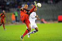 USA's Juan Agudelo (r) and Belgium's Vincent Kompany fight for the ball during the friendly match Belgium vs USA at King Baudoin stadium in Brussels, Belgium on September 06th, 2011.