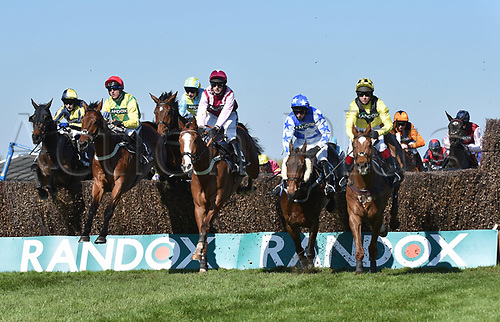 April 8th 2017, Aintree Racecourse, Liverpool, England; Randox Health Grand National Festival Horse racing, Grand National Day; Winner Sizing Codelco ridden by Robbie Power is neck and neck with Emerging Force ridden by David Bass and Lamb or Cod ridden by Richard Johnson early in the Betware Handicap Chase