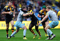 Christian Wade of Wasps takes on the Northampton Saints defence. Aviva Premiership match, between Wasps and Northampton Saints on April 3, 2016 at the Ricoh Arena in Coventry, England. Photo by: Patrick Khachfe / JMP