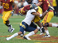 Sean Cattouse of California tackles C.J. Cable of USC during the game at LA Memorial Coliseum in Los Angeles, California.  USC defeated California, 48-14.