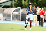 27 September 2009: North Carolina's Nikki Washington watches pregame warmups with a brace on her injured right leg. The University of North Carolina Tar Heels defeated the Wake Forest University Demon Deacons 4-0 at Fetzer Field in Chapel Hill, North Carolina in an NCAA Division I Women's college soccer game.