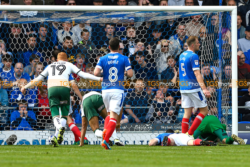 Ryan Taylor of Plymouth Argyle left starts to celebrate as Jake Jervis of Plymouth Argyle bundles the ball over the line for the first goal during Portsmouth vs Plymouth Argyle, Sky Bet EFL League 2 Football at Fratton Park on 14th April 2017