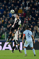 26th November 2019; Allianz Stadium, Turin, Italy; UEFA Champions League Football, Juventus versus Atletico Madrid; Mattia De Sciglio of Juventus clears the ball with a header over Koke of Atletico - Editorial Use