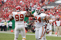 Chiefs cornerback Ty Law gets a high-five from Kendrell Bell for a tackle in the first quarter at Arrowhead Stadium in Kansas City, Missouri on September 10, 2006. The Cincinnati Bengals won 23-10.