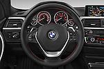 Car pictures of steering wheel view of a 2014 BMW SERIES 3 Sport 4 Door Sedan 2WD Steering Wheel