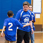 TORRINGTON,  CT-031919JS08- Torrington Middle School's unified basketball platers congratulate one another after scoring during their game against Avon Middle School Tuesday at Torrington Middle School. It was the first home game for Torrington. <br /> Jim Shannon Republican American
