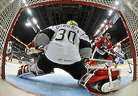 San Antonio Rampage goaltender Scott Clemmensen guards the net from Rockford IceHogs' Brad Winchester during the first period of an AHL hockey game, Saturday, Oct. 5, 2013, in San Antonio. (Darren Abate/M3D14.com)