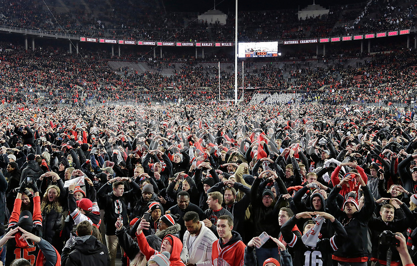 "Ohio State fans and players sing ""Carmen Ohio"" following the Buckeyes' 39-38 win over Penn State in the NCAA football game at Ohio Stadium in Columbus on Oct. 28, 2017. [Adam Cairns/Dispatch]"