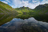 Mountain reflection in lake Utdalsvatnet, Unstad, Vestvågøy, Lofoten Islands, Norway