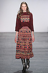 """Model Helga walks runway in a boiled wool raglan sweater with embroidered lace applique in mahogany, with embroidere lace maxi skirt, from the Vivienne Tam Fall Winter 2016 """"Cultural Dreamland The New Silk Road"""" collection, presented at NYFW: The Shows Fall 2016, during New York Fashion Week Fall 2016."""