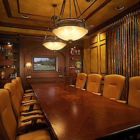 Handsome conference room with iron accents and wood marquetry inset at the conference table.