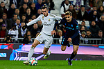 Gareth Bale of Real Madrid and Diego Llorente of Real Sociedad during La Liga match between Real Madrid and Real Sociedad at Santiago Bernabeu Stadium in Madrid, Spain. November 23, 2019. (ALTERPHOTOS/A. Perez Meca)