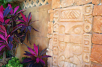 Pre-Columbian carvings on the facade of La Habichuela restaurant in downtown Cancun, Quintana Roo, Mexico