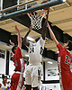 Fabien Holder #34 of Holy Trinity, center, drives to the net during a Nassau-Suffolk CHSAA varsity boys basketball game against St. John the Baptist at Holy Trinity High School on Friday, Feb. 3, 2017.
