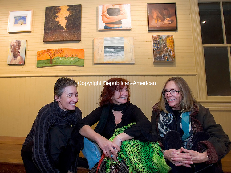 KENT, CT- 22 NOVEMBER 2008 --112208JS08- Violaine Bachlier, left, the widow of the late,  Jacques Kaplan, talks with artists Marguerite Takvorian-Holmes of East Greenwich, NY, center, and Carroll Macdonald of Bridgewater during the opening of a collection titled 'A memorial for Jacques with 100 artists' held at the Bachelier Cardonsky Gallery in Kent. The show is to celebrate the life of the late Jacques Bachelier, owner of the Bachelier Cardonsky Gallery before his death last summer. The show continues through December 21, 2008.                                                                                                                            <br /> Jim Shannon / Republican-American