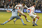 Andreu Fontas of Sporting KC (left) and Toluca players Emmanuel Gigliotti (center) and Federico Mancuello vie for the ball during their CONCACAF Champions League game on February 21, 2019 at Children's Mercy Park in Kansas City, KS.<br /> Tim VIZER/Agence France-Presse
