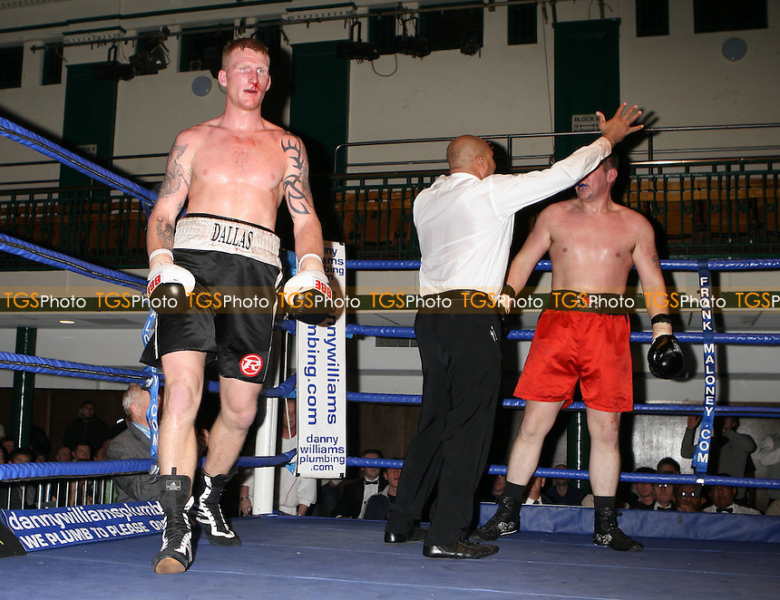 Tom Dallas (Chatham, black shorts) defeats Howard Daley (Preston, red shorts) in a Heavyweight boxing contest at York Hall Bethnal Green, promoted by Frank Maloney / FTM Sports - 15/11/08 - MANDATORY CREDIT: Gavin Ellis/TGSPHOTO - Self billing applies where appropriate - 0845 094 6026 - contact@tgsphoto.co.uk - NO UNPAID USE.